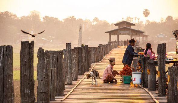 MANDALAY, MYANMAR - APRIL 7, 2012 : Morning life at Ubein Bridge (the longest wooden bridge in the world), Mandalay, Myanmar