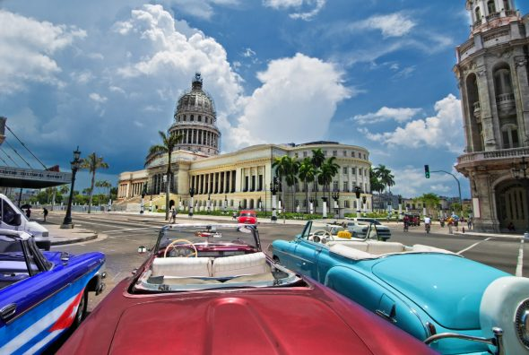 View of Havana capitol building from a parked oldtimer